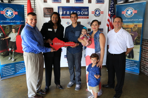 Wells Fargo Bank, Operation Homefront, and Brick House Tavern + Tap joined forces to present a mortgage-free home to U.S. Marine Corporal Esteban Russi and his family. (Photo: Business Wire)