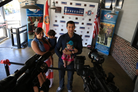 U.S. Marine Corporal Esteban Russi and his family. (Photo: Business Wire)