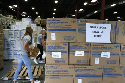 Project C.U.R.E. volunteers prepare urgently needed exam gloves and medical supplies for shipping to ...