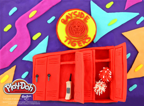 """Grab your pom poms, call your friends, and get in the spirit to celebrate National PLAY-DOH Day! Bayside High takes new shape in this """"Saved by the Bell"""" inspired PLAY-DOH sculpture, featuring a few favorite accessories belonging to 90s high school sweethearts Zack and Kelly. To celebrate National PLAY-DOH Day on September 16, the PLAY-DOH brand is headed back to school with six sculptures inspired by schools and students in pop culture. Be sure to visit the PLAY-DOH Facebook page to check out how the brand is celebrating the annual holiday: https://www.facebook.com/playdoh Saved by the Bell is a trademark and copyright of NBCUniversal Media, LLC. Licensed by Universal Studios Licensing LLC. All Rights Reserved. (Photo: Business Wire)"""