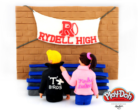 "Rydell High is back in session and the PLAY-DOH brand is going to rule the school! Hasbro Inc. and the PLAY-DOH brand have sculpted a T-Bird and one of the Pink Ladies in a unique PLAY-DOH rendition of ""Those Summer Nights"" to celebrate National PLAY-DOH Day on September 16, 2014. Stop by the PLAY-DOH Facebook page to see five other school scenes inspired by pop culture classics: https://www.facebook.com/playdoh (Photo: Business Wire)"