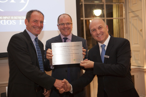George Freeman, Minister for Life Sciences presents Christophe Berthoux, CEO of Synexus and Professor Richard Walker, clinical director of research and development at Northumbria Healthcare NHS Foundation Trust with the plaque for the new Synexus North East Research Centre in Hexham (Photo: Business Wire)