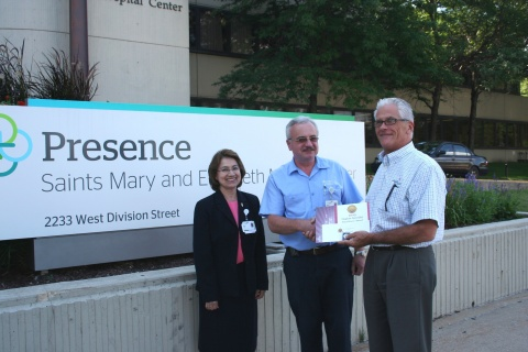 Zinoviy Gunyak (center) is the 2013 recipient of the Hygiene Specialist Excellence award sponsored by UMF Corporation. Gunyak is a member of the Environmental Services Team at Presence Saints Mary and Elizabeth Medical Center, Chicago. He is pictured with the hospital's ES Director Maria Roman, REH, who nominated him for the award, and UMF Corporation CEO George Clarke. (Photo: Business Wire)