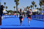CAF Elite Paratriathlon Team member Patricia Walsh and her guide complete a race together. (Photo: Business Wire)