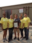 Left to right: On Ernst & Young LLP's annual EY Connect Day, Gina Moore, Natalia Hailen, CJ Obmann (Ernst & Young LLP Managing Partner for the Sacramento office), Angela Basi, and Ray Loyd proudly display Mayor Kevin Johnson's EY Connect Day proclamation while volunteering at the Placer Food Bank. (Photo: Business Wire)