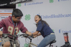 Ruben (12) and Keishla Bolivar (12) from Calabasas Middle School create their own healthy smoothies using specially-made blender bikes donated to Arizona 4-H by UnitedHealthcare as part of a $40,000 grant announced today at the Santa Cruz County Fair that will promote healthy living among youth (Photos by Tom Freeland for UnitedHealthcare).