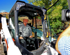 Bobcat Million Loaders Contest Winner Steven Klumker assumes the controls of his new special-edition compact track loader after being surprised by Bobcat officials. (Photo: Stoklos Photography)