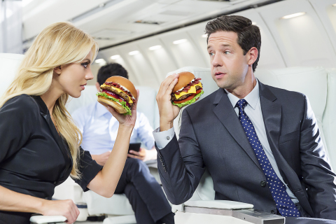 "Model and actress Bar Paly (""Pain & Gain,"" ""Million Dollar Arm"") will star in a new national TV advertising campaign to promote the Mile High Bacon Cheese Thickburger that will begin airing next week. Titled ""Propositioning,"" the spot is set aboard an airplane mid-flight, where Paly asks her on-set husband to join her in the Mile High Club. (Photo: CKE Restaurants/Fab Fernandez)"