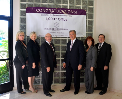 Berkshire Hathaway HomeServices today named its 1,000th office, a milestone reached in exactly one year from the brokerage network's launch. The distinction belongs to Torrance, CA-based Berkshire Hathaway HomeServices California Properties and its Torrance/Skypark headquarters. Berkshire Hathaway HomeServices Senior Vice President Lou Gonzalez (third from right) joins the brokerage's leadership team of (from left) Mistydawn Jones, Jerrie Short, Bruce Short, Denise Scarpetti and Rick Elorriaga in commemorating the distinction. (Photo: Business Wire)