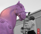P.F. Chang's CEO Rick Federico helps paint the restaurant's iconic Warrior Horses pink for National Breast Cancer Awareness Month. The company is raising $100,000 for the cause in October. (Photo: Business Wire)