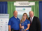 John Mouser, President of TekSolv and Amye McDearmon, TekSolv Marketing & Communications Manager pictured with the 2014 SGICC EH&S Award along with Bill Hall, SGICC Director. (Photo: Business Wire)