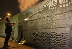 Reverse Graffiti artist Moose creating the London skyline (Photo: Business Wire)