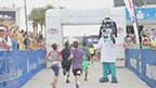 Young athletes are crossing the finish line with UnitedHealthcare mascot Dr. Health E. Hound at the 2013 UnitedHealthcare IRONKIDS Las Vegas Fun Run (Video: Gabriel Lapuz).