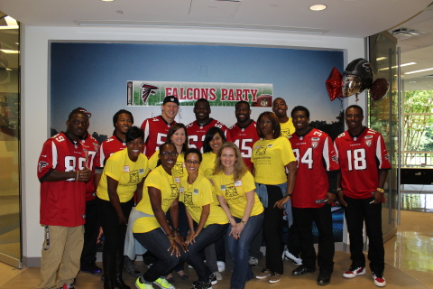 UnitedHealth Group volunteers and rookie players from the Atlanta Falcons brought a carnival-themed Project Sunshine party to the patients and families at Children's Healthcare of Atlanta (Photo: Project Sunshine).