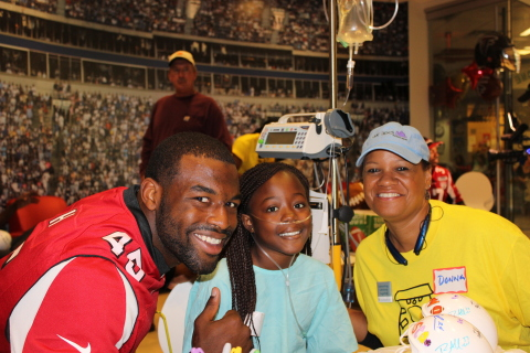 Atlanta Falcon Jacques Smith with a UnitedHealth Group volunteer and patient from Children's Healthcare of Atlanta, at today's Project Sunshine party (Photo: Project Sunshine).