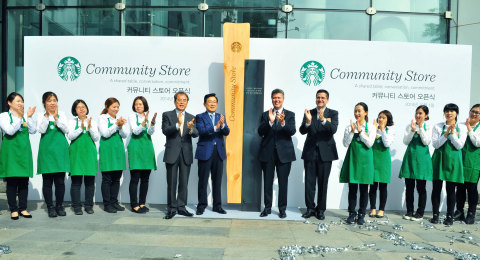 Starbucks partners with (center) Lee Je-Hoon, president, Green Umbrella ChildFund Korea; S.K. Lee, president, Starbucks Korea; John Culver, group president, Starbucks Coffee China and Asia Pacific, Channel Development and Emerging Brands; and Jeff Hansberry, president, Starbucks China and Asia Pacific, celebrating the first Community Store in Korea. (Photo: Business Wire)
