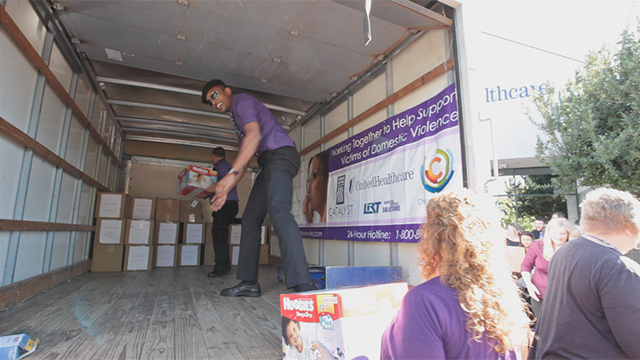 UnitedHealthcare's Chico office employees help load boxes of food and everyday items onto a truck to be delivered to Catalyst Domestic Violence Services' emergency shelter on Wednesday, Oct. 1. UnitedHealthcare employees and Chico Chamber of Commerce helped highlight October's Domestic Violence Awareness month by delivering more than 4,000 pounds of food and dozens of boxes of everyday necessities such as toothbrushes, soap and blankets for Catalyst's emergency shelter (Video: Brian Peterson).