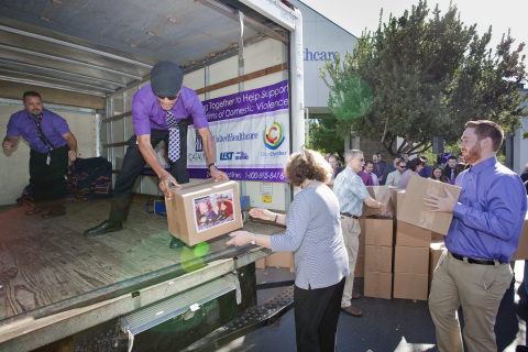 Butte County Supervisor Maureen Kirk (middle right) and UnitedHealthcare employees (left to right) Shannon Cloud, Matthew Turner and Chris Plymesser on Wednesday, Oct. 1, help load boxes of food and everyday items onto a truck to be delivered to Catalyst Domestic Violence Services emergency Shelter. UnitedHealthcare employees and Chico Chamber of Commerce helped highlight October's Domestic Violence Awareness month by delivering more than 4,000 pounds of food and dozens of boxes of everyday necessities such as toothbrushes, soap and blankets for Catalyst's emergency shelter (Photo: Brian Peterson).