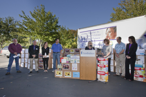 Pam Jamian (at podium), UnitedHealthcare's Chico site director, on Wednesday, Oct. 1, announces UnitedHealthcare employees have collected 4,000 pounds of food and everyday items for Catalyst Domestic Violence Services' emergency shelter to help highlight October's Domestic Violence Awareness Month as community leaders look on. Left to right: Mike Maloney, former Chico police chief; Chico Mayor Scott Grendl; Katie Simmons, president and CEO, Chico Chamber of Commerce; Chico City Councilmember Randall Stone; Butte County supervisors Maureen Kirk and Larry Wahl; and Anastacia Snyder, Catalyst executive director (Photo: Brian Peterson).