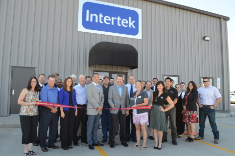 Intertek personnel from the new North Dakota facility and USA management join together to cut the ribbon and open this new, large, petroleum laboratory dedicated to the region's Oil & Gas industry. (Photo: Business Wire)