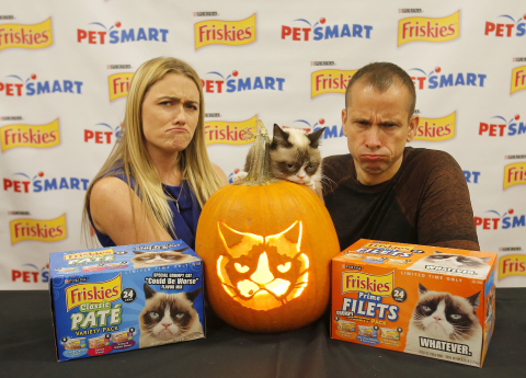 To kick off a Halloween promotion, Friskies® and PetSmart brought Grumpy Cat face-to-face with the first-ever Grump-O-Lantern carved by famed sculptor Ray Villafane at a PetSmart store in Surprise, AZ on Thursday, October 2. Fans can download the exclusive Friskies stencil at www.PetSmart.com/Friskies and purchase Friskies variety packs featuring Grumpy Cat at a local store PetSmart store while supplies last. (Rick Scuteri/AP Images for Friskies/PetSmart Halloween Promotion)