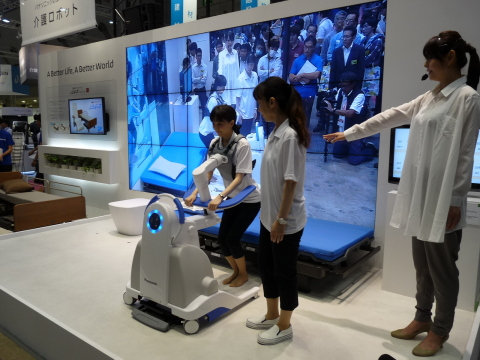 Self-reliance support robot (prototype) helps users get in and out of bed. (Photo: Business Wire)