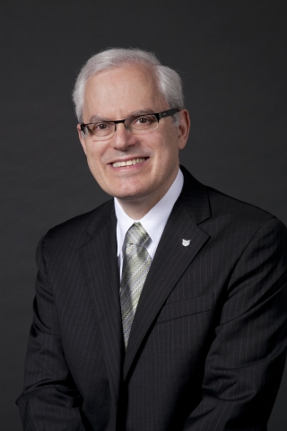 Seymour Liebman, executive vice president, chief administrative officer and general counsel of Canon