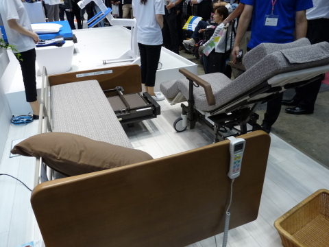 "A portion of the electric care bed, ""Resyone,"" transforms into an electric wheelchair. The first product in the world to obtain global safety standard ISO13482 for service robots. (Photo: Business Wire)"