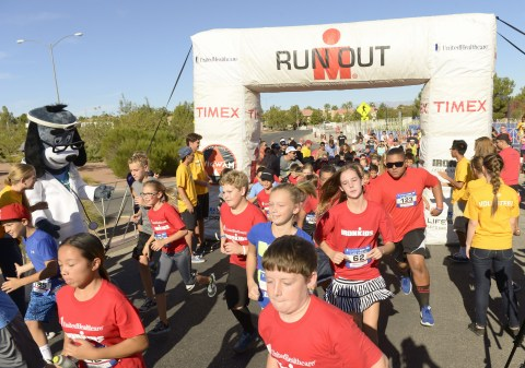More than 200 youth and UnitedHealthcare's Dr. Health E. Hound take off for the finish line at this