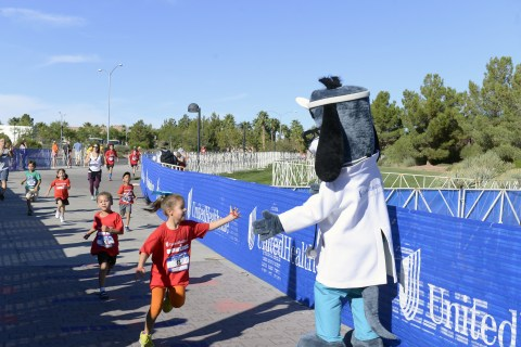 """UnitedHealthcare mascot Dr. Health E. Hound is pictured at the finish line of the UnitedHealthcare IRONKIDS Las Vegas Fun Run at Henderson Pavilion. More than 200 youth participated in today's race for """"triathletes to be."""" (Photo credit: Bryan Steffy)"""