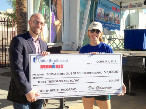UnitedHealthcare of Nevada chief medical officer, Dr. Laurine Tibaldi, presents a $3,000 cheque to Brian Knudson, president, Boys & Girls Clubs of Southern Nevada, to support the Club's healthy living programs. (Photo credit: Bryan Steffy)