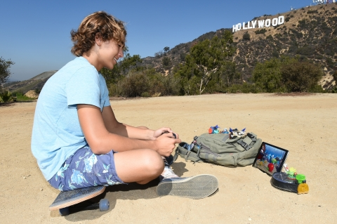 In their quest to capture evil and unleash good in Skylanders Trap Team, Portal Masters around the world traveled to iconic locations to play the game. Here, a fan enjoyed playing Skylanders Trap Team in Hollywood Hills at the Hollywood sign. (Photo: Business Wire)