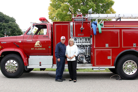 Axalta's Ken Hohlbein and Attendee Denise Froehlich with Axalta manufacturing plant fire truck during Macomb County Business Preparedness Conference. (Photo: Business Wire)