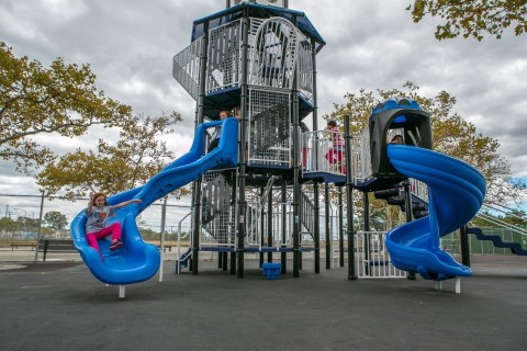 Students from Midland Beach, Staten Island enjoying their new playground and 25-foot lighthouse themed Miracle Mega Tower® (Photo: Business Wire)