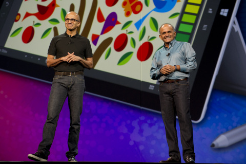 Adobe President and Chief Executive Officer Shantanu Narayen, (right) and Microsoft Chief Executive Officer Satya Nadella take the stage at Adobe MAX to announce that all 5,000 attendees will receive a Microsoft Surface Pro 3, one year subscription to Office 365 and 1TB of storage on Microsoft OneDrive on Monday, Oct. 6, 2014 in Los Angeles. The annual event is the largest gathering of creative professionals from the design, Web, photography, video, film, television and media industries. (Photo: Business Wire)
