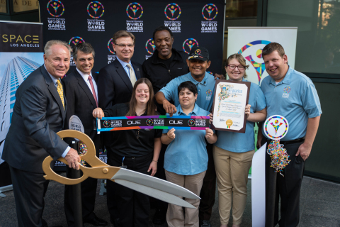 Special Olympics World Games 2015 celebrates the opening of their new headquarters with OUE Limited. From left to right: Council Member Tom LaBonge, OUE Limited President and CEO Richard Stockton, President and CEO of LA2015 Patrick McClenahan, Olympic Champion and Special Olympics Southern California Founder Rafer Johnson and World Games Global Messengers. (Photo credit: Jason Tully)