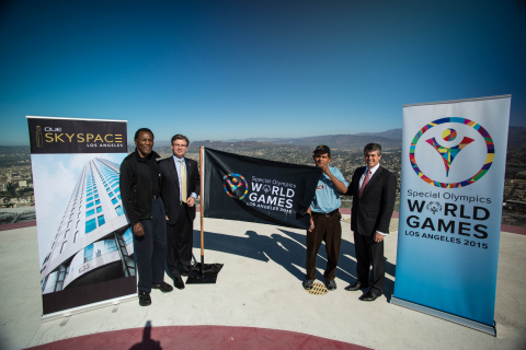 Special Olympics World Games 2015 Celebrates the opening of their new headquarters with OUE Limited on the helipad of the US Bank Tower. From left to right: Olympic Champion and Special Olympics Southern California Founder Rafer Johnson, President and CEO of LA2015 Patrick McClenahan, World Games Global Messenger Marco Martinez and OUE Limited President and CEO Richard Stockton. (Photo credit: Jason Tully)