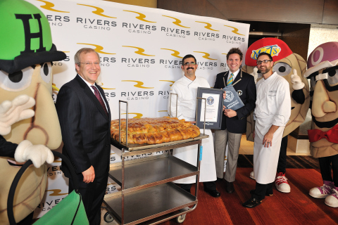 Pittsburgh's Rivers Casino has set a new GUINNESS WORLD RECORDS title for largest pierogi. The dumpling, filled with potatoes and cheddar cheese, weighed in at 123 pounds. Left to right: General Manager Craig Clark, Executive Chef Richard Marmion, Guinness World Records Adjudicator Michael Empric and Assistant Executive Chef Adam Tharpe. (Photo: Business Wire)