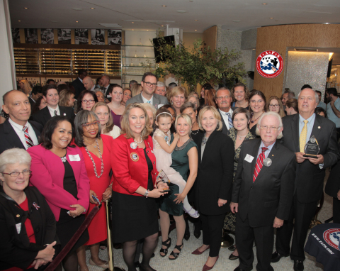 Former Secretary of State Hillary Clinton with surviving military families from TAPS, the Tragedy Assistance Program for Survivors. Secretary Clinton received the Lifetime Service Award in recognition of her support for the organization over the last decade. (Photo: Business Wire)