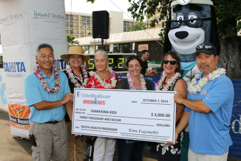 Just before the UnitedHealthcare IRONKIDS Keiki Dip-n-Dash, UnitedHealthcare mascot Dr. Health E. Hound helps present a $3,000 check to Kama'aina Kids to support its youth health programs. (Left to right: Dr. Ron Fujimoto, UnitedHealthcare; Rep. Cindy Evans; Councilmember Karen Eoff; Rep. Nicole Lowen; Barbara Dalton, Governor's West Hawaii representative; Dr. Hound, UnitedHealthcare; and Mark Nishiyama, Kama'aina Kids) Photo Source: Kirk Lee Aeder