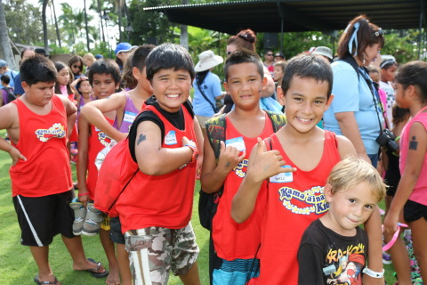 Local youth from Kama'aina Kids show off their game faces as they prepare to compete in the UnitedHealthcare IRONKIDS Keiki Dip-n-Dash. From L to R: William Huihui-Wilton, Daniel Alcos-Penovaroff, Keanu Cerezo and Nathanael Perez of the Big Island. Photo Source: Kirk Lee Aeder