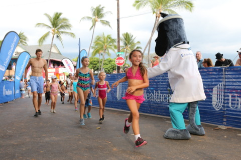 "Kylie Morones from Kama'aina Kids smiles as she crosses the finish line, becoming an ""IRONKID"" at the UnitedHealthcare IRONKIDS Keiki Dip-n-Dash. Photo Source: Kirk Lee Aeder"