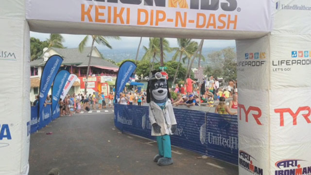 Young athletes, including nearly 100 from Kama'aina Kids are congratulated by UnitedHealthcare's mascot Dr. Health E. Hound as they cross the finish line and become IRONKIDS at the 2014 UnitedHealthcare IRONKIDS Keiki Dip-n-Dash. Video Source: Kevin Herglotz