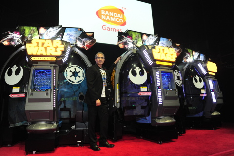President and CEO BANDAI NAMCO Amusement America Inc., John McKenzie, unveils Star Wars™ Battle Pod™ arcade game, Wednesday, Oct 8th, 2014, in New York, NY (Photo: Business Wire)