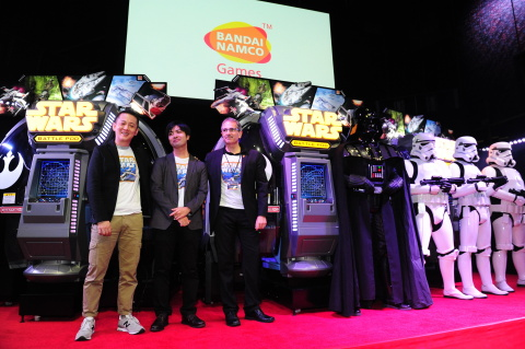 President and CEO BANDAI NAMCO Amusement America Inc., John McKenzie, with Producer on this game BANDAI NAMCO Games Inc. Kazushi Imoto and Executive Producer BANDAI NAMCO Games Inc. Kazutoki Kono, debuts Star Wars™ Battle Pod™ BANDAI NAMCO Games Inc. arcade game, Wednesday, Oct 8th, 2014, in New York, NY (Photo: Business Wire)