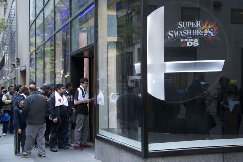 In this photo provided by Nintendo of America, Nintendo fans stop by Nintendo World in New York on O ...