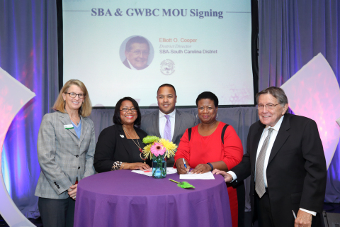 L to R: Lisa Johnson, Roz Lewis, Cassius Butts, Terri L. Denison, Elliott O. Cooper Sign Historic Agreement. Photo Credit: Hope Productions Unlimited, Inc.