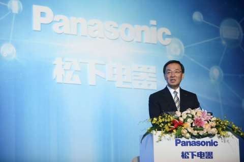 Panasonic President Kazuhiro Tsuga making a speech at the 35th anniversary ceremony of its China bus ...