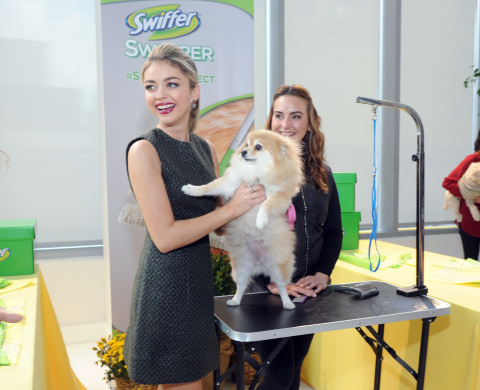 Modern Family's Sarah Hyland explains how grooming clean-up is made easier with the Swiffer Sweeper, Tuesday, Oct. 21, 2014, in New York. Swiffer announced a year-long effort to help support the ASPCA in finding homes for animals in need and help make the challenges of cleaning up after a pet less of a concern after adoption. (Photo by Diane Bondareff/Invision for Swiffer/AP Images)