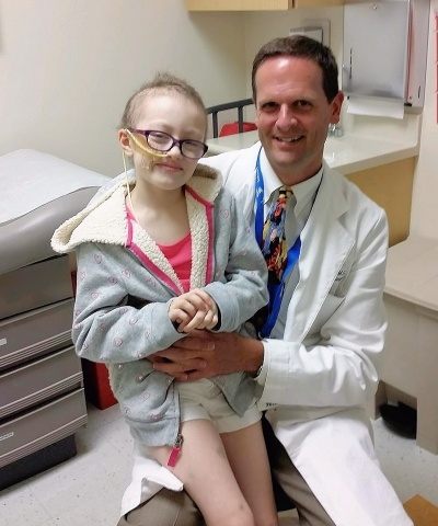 Emily Zimmerman of Reno, now 8, is pictured with Gerald Grant, MD, chief of pediatric neurosurgery at Stanford Children's Health. (Photo: Business Wire)